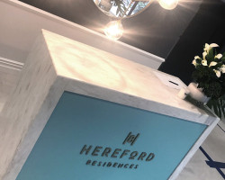 Hereford Residences reception signage